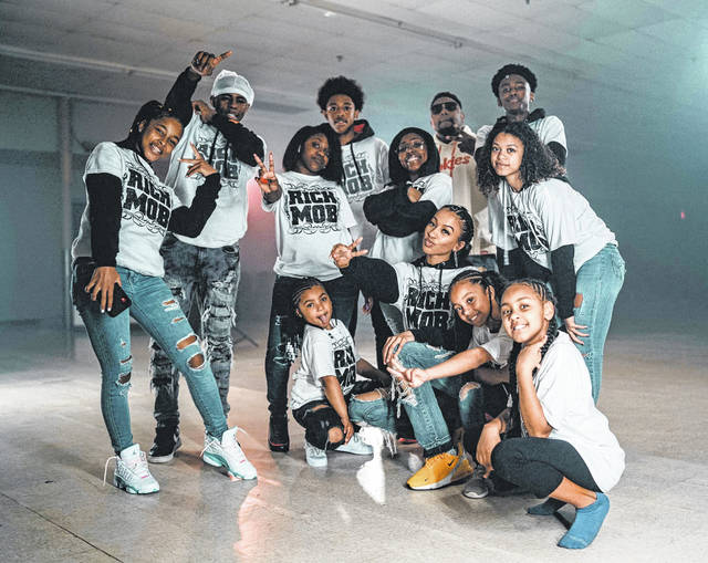 """In April, Coleman held a video shoot of the Bean City Glide featuring the winners of the dance contest organized into a dancing troupe called the """"Rich Mob."""""""
