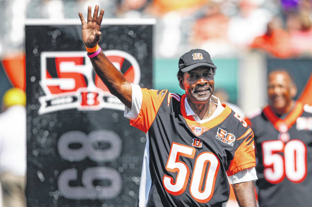 FILE - In a Sunday, Sept. 10, 2017, file photo, former Cincinnati Bengals cornerback Ken Riley waves to the crowd during a halftime 50th anniversary ceremony of an NFL football game against the Baltimore Ravens, in Cincinnati. Former Cincinnati Bengals standout Ken Riley, who was later a head coach and athletic director at his alma mater Florida A&M, died Sunday, June 7, 2020, the university announced. He was 72.(AP Photo/Gary Landers, File)