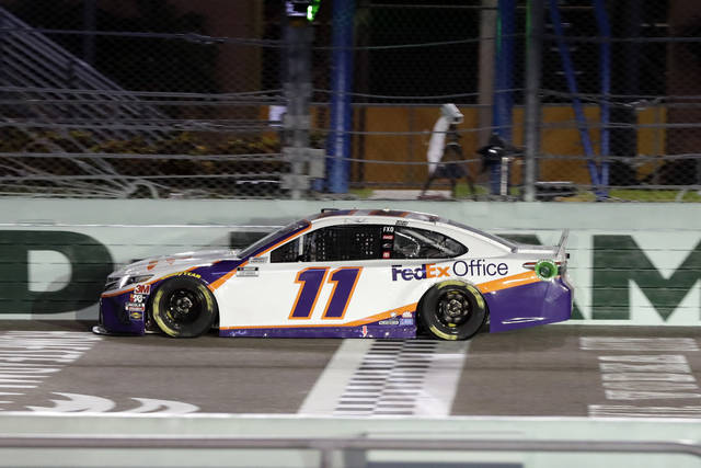Denny Hamlin crosses the finish line to win a NASCAR Cup Series auto race Sunday, June 14, 2020, in Homestead, Fla. (AP Photo/Wilfredo Lee)