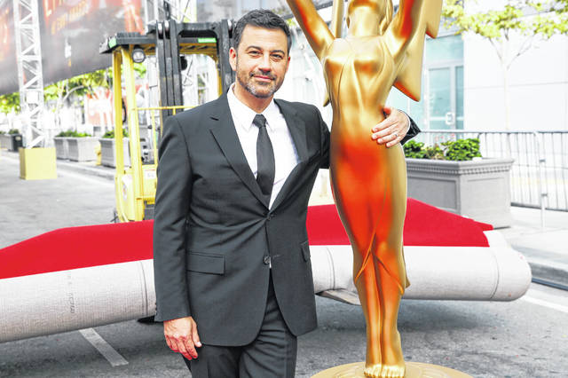 Jimmy Kimmel poses for a photo with a replica of an Emmy statue in 2016 at the Primetime Emmy Awards Press Preview Day in Los Angeles. Kimmel will return as host and will serve as executive producer for the 72nd Emmy Awards on Sunday, Sept. 20, on ABC.