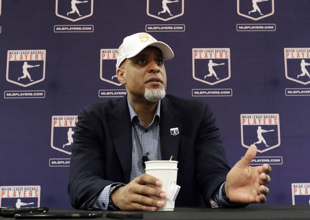 In this Feb. 19, 2017, file photo, Major League Players Association Executive Director Tony Clark, answers questions at a news conference in Phoenix. Commissioner Rob Manfred says there might be no major league season after a breakdown in talks between teams and the union on how to split up money in a season delayed by the coronavirus pandemic. The league also said several players have tested positive for COVID-19. Two days after union head Clark declared additional negotiations futile, Deputy Commissioner Dan Halem sent a seven-page letter to players' association chief negotiator Bruce Meyer asking the union whether it will waive the threat of legal action and tell MLB to announce a spring training report date and a regular season schedule. (AP Photo/Morry Gash, File)