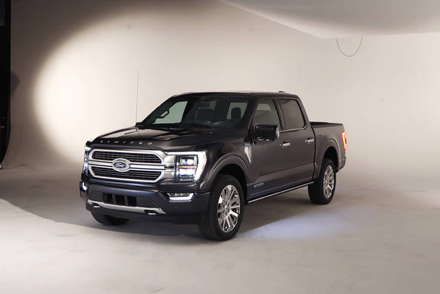 In a photo from, Wednesday, June 24, 2020, the new 2021 Ford F-150 truck is photographed in Ferndale, Mich. Six years ago, Ford bet big on the top-selling vehicle in America, rolling out a radical new version of the F-Series pickup with a lighter aluminum body instead of steel. Now it's time for another revamp, and Ford is playing it safe. On the outside, the truck changes little. The biggest differences are a gas-electric hybrid version, internet connectivity, and a revamped interior that turns the truck into more of a rolling office or even a place to nap. (AP Photo/Carlos Osorio)