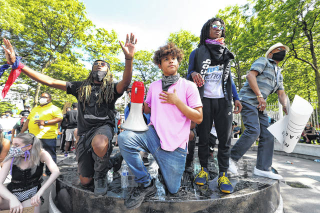 Stefan Perez, second from left, addresses a crowd at a rally June 3 in Detroit over the death of George Floyd. In big cities and small towns, whether liberal or conservative, the new young organizers are taking matters into their own hands and bringing together hundreds or thousands of people to peacefully press for change.