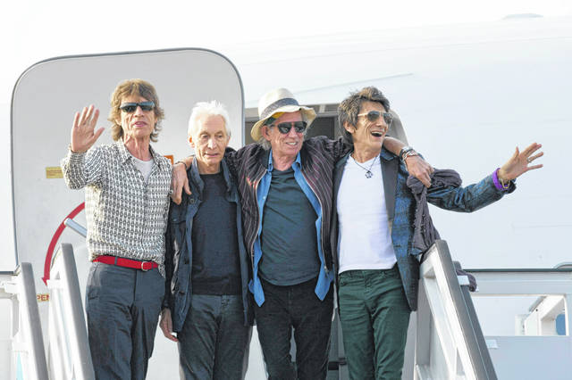 Members of The Rolling Stones, from left, Mick Jagger, Charlie Watts, Keith Richards and Ron Wood pose for photos from their plane at Jose Marti international airport in Havana, Cuba, in 2016. The Rolling Stones are threatening U.S. President Donald Trump with legal action for using their songs at his reelection campaign rallies despite cease-and-desist directives, according to a statement issued by the band Sunday.