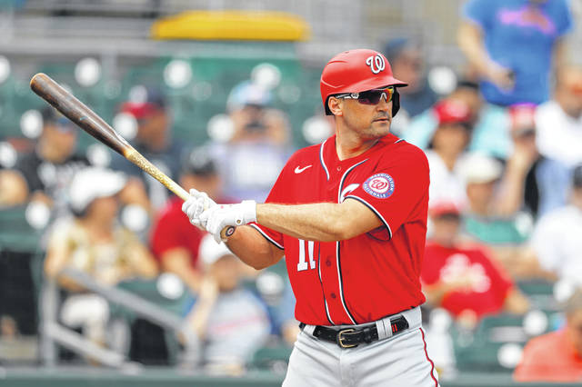 FILE - In this Tuesday, March 10, 2020, file photo, Washington Nationals' Ryan Zimmerman waits for a pitch from Miami Marlins pitcher Caleb Smith during the first inning of a spring training baseball game, in Jupiter, Fla.  Longtime infielder Ryan Zimmerman and pitcher Joe Ross are opting out of playing the 2020 season as Major League Baseball tries to get back amid the COVID-19 pandemic. General manager Mike Rizzo says the team is 100% supportive of Zimmerman and Ross deciding not to play. (AP Photo/Julio Cortez, File)