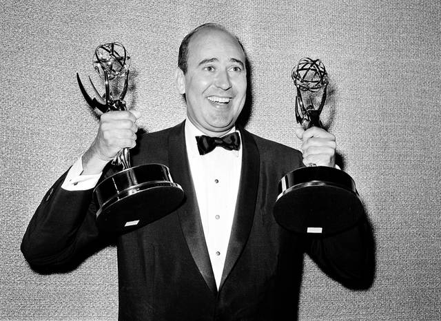 "FILE - In this May 26, 1963 file photo, Carl Reiner shows holds two Emmy statuettes presented to him as best comedy writer for the ""Dick Van Dyke Show,"" during the annual Emmy Awards presentation in Los Angeles. Reiner, the ingenious and versatile writer, actor and director who broke through as a ""second banana"" to Sid Caesar and rose to comedy's front ranks as creator of ""The Dick Van Dyke Show"" and straight man to Mel Brooks' ""2000 Year Old Man,"" has died, according to reports. Variety reported he died of natural causes on Monday night, June 29, 2020, at his home in Beverly Hills, Calif. He was 98. (AP Photo, File)"