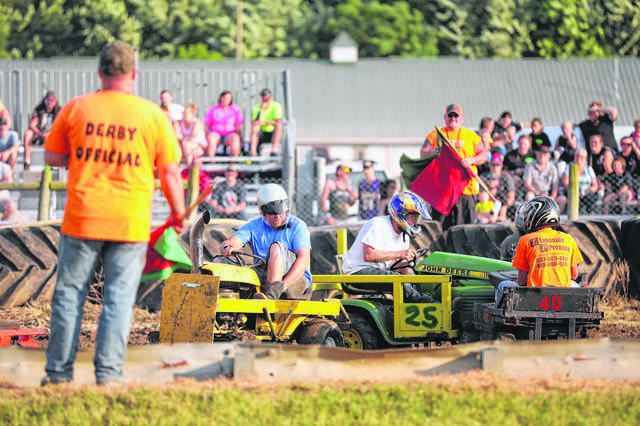 People compete during a past lawnmower demo derby at the Putnam County Fair.