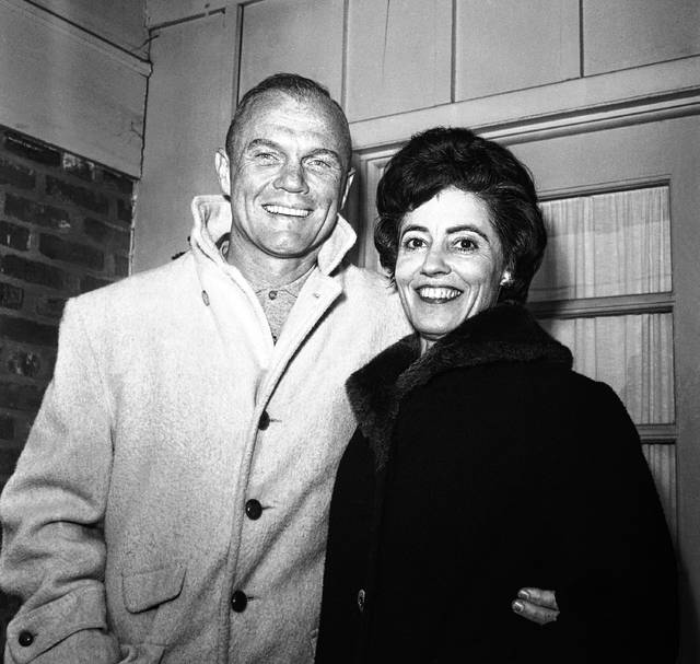 In this Feb. 3, 1962 file photo, astronaut John Glenn poses with his wife, Annie, outside their Arlington, Va., home during his first news conference. Glenn, the widow of astronaut and U.S. Sen. John Glenn and a communication disorders advocate, died Tuesday, May 19, 2020, of COVID-19 complications at a nursing home near St. Paul, Minn., at age 100.