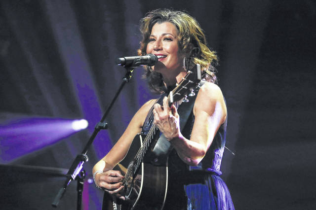 "FILE - In this Oct. 15, 2019 file photo, singer Amy Grant performs during the Dove Awards in Nashville, Tenn. Grant has had open heart surgery to fix a heart condition she has had since birth. A publicist for the singer said doctors discovered the condition during a routine checkup. Grant is married to country singer Vince Gill and is a six-time Grammy winner with hits like ""Baby, Baby,"" and ""That's What Love is For."""