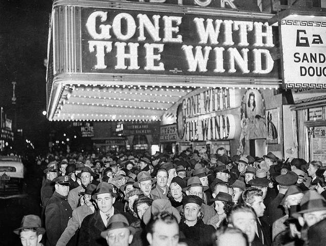 "FILE - In this Dec. 19, 1939 file photo, a crowd gathers outside the Astor Theater on Broadway during the premiere of ""Gone With the Wind"" in New York. HBO Max has temporarily removed ""Gone With the Wind"" from its streaming library in order to add historical context to the 1939 film long criticized for romanticizing slavery and the Civil War-era South."