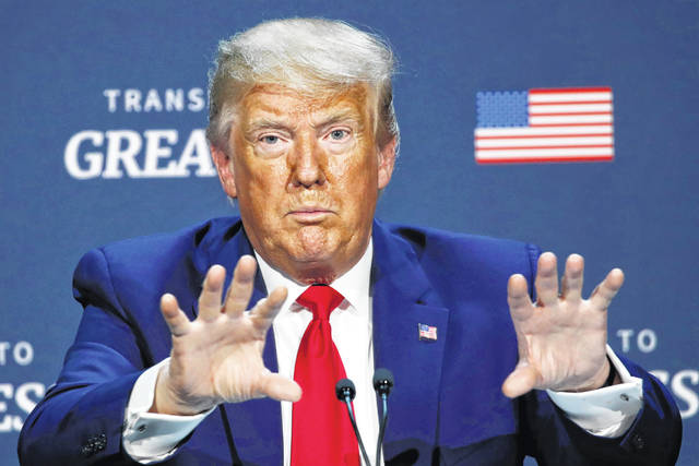 """President Donald Trump speaks during a roundtable discussion about """"Transition to Greatness: Restoring, Rebuilding, and Renewing,"""" at Gateway Church Dallas, Thursday, June 11, 2020, in Dallas."""