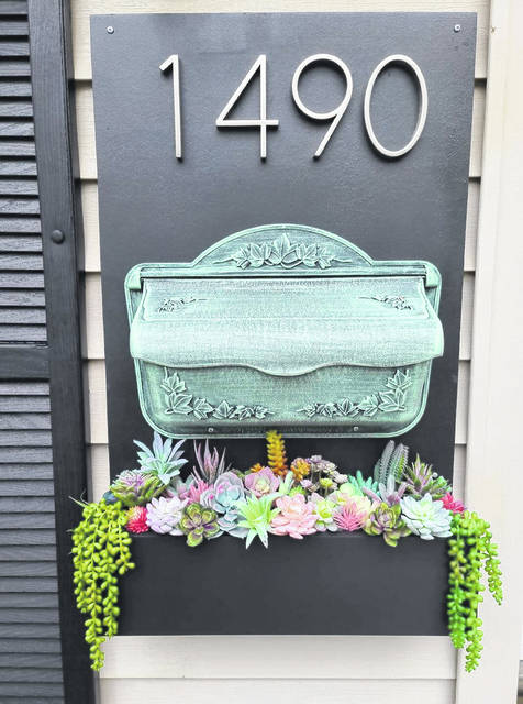 Ashley Oleviri, of Lima, combined ideas from Etsy and Pinterest to create her own address and mailbox planter.
