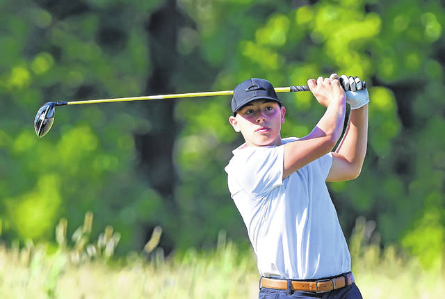 Ottoville's Carter Schnipke watches his tee shot during Tuesday's Gray's Cappie Sportswear Open at Springbrook Golf Club.