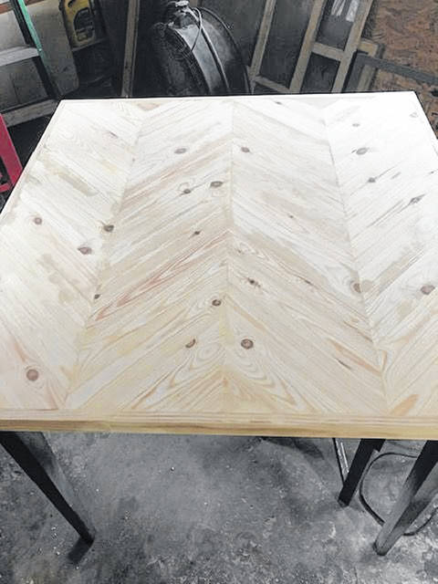 Bevilockway cut wood pieces and placed them together to create the new tabletop.