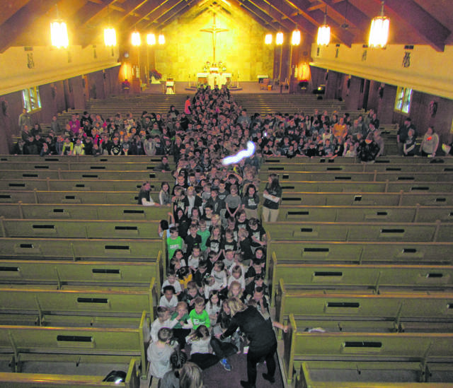 Students from Catholic schools in Putnam County form the shape of the cross during Catholic Schools Week in January. While the coronavirus pandemic forced the closure of some schools nationally, local Catholic educators say they're weathering the storm.