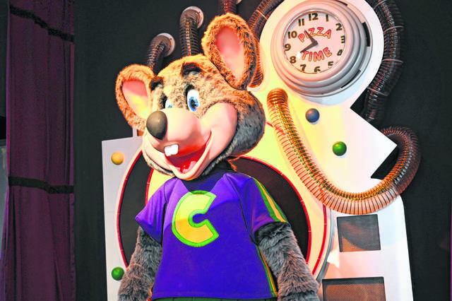 The Chuck E. Cheese mascot visits a birthday party at the Lima location last July. The Lima entertainment venue closed as part of the parent company's response to COVID-19.