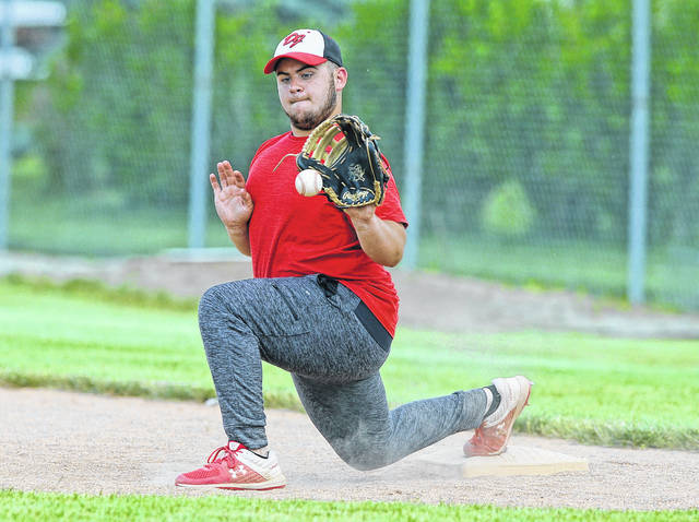 Delphos Jefferson's Jackson Ream retrieves a throw at first base during a Friday practice at the high school.