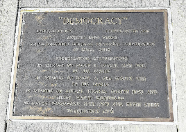 "A plaque in front of the ""Democracy""  sculpture at Lima Senior High School. Craig J. Orosz 