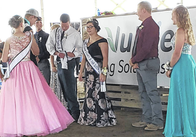 Cody Meyer adjusts his sash after being named the Putnam County Fair King on Monday afternoon. Next to him is Ashley Maag, who was selected as the Putnam County Fair Queen.