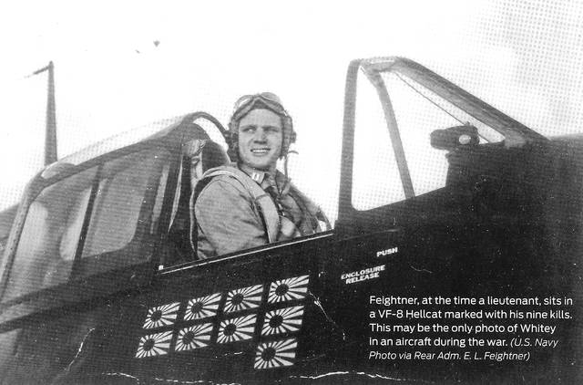 Feightner in a VF-8 Hellcat during World War II. The flags mark his nine kills.
