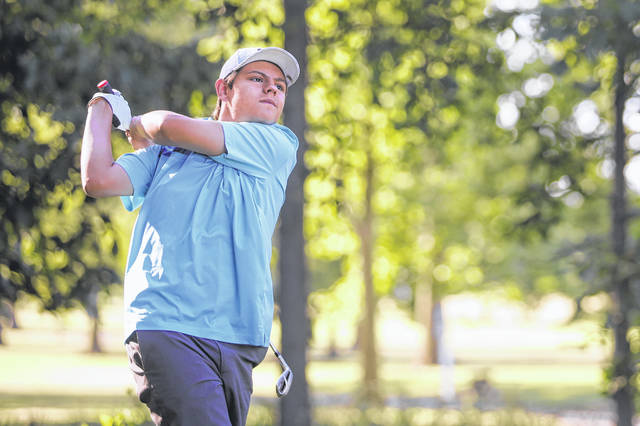 Ottawa-Glandorf's Dylan Meyer watches his tee shot during Thursday's Bach Promotional Products Open at Sycamore Springs.