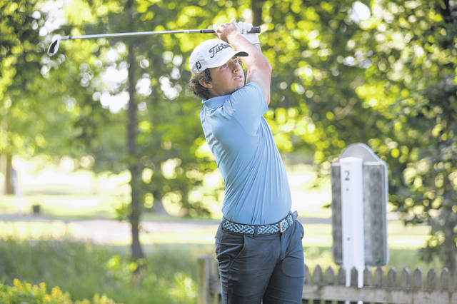 Waynesfield Goshen's Hyatt Kaufman watches his tee shot during Thursday's Bach Promotional Products Open at Sycamore Springs.