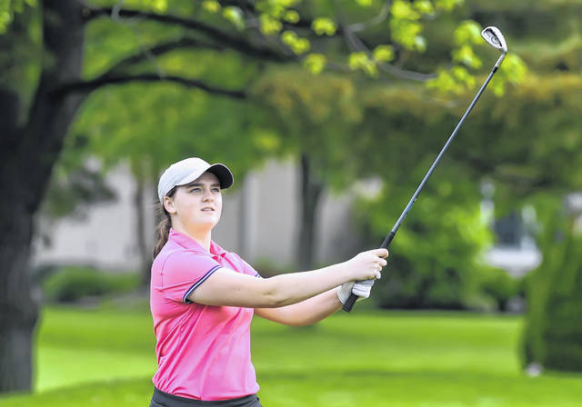 Lima Central Catholic's Bridget Mulcahy watches her tee shot on the 18th hole during Thursday's Eagles Aerie #370 Open at Tamarac Golf Course.