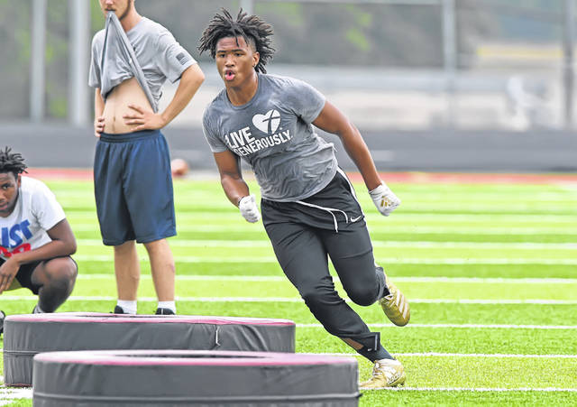 Lima Senior's Isaiah Russell runs a drill during Monday's practice at Spartan Stadium.