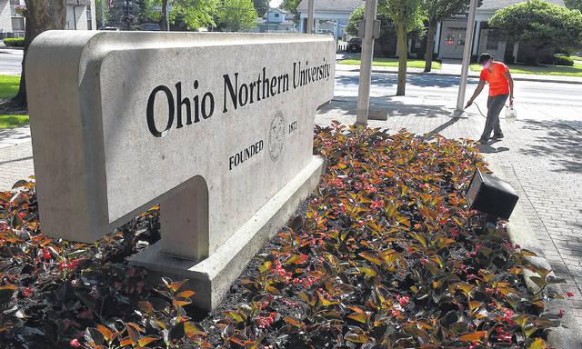 Pam Clum, a grounds crew member at Ohio Northern University in Ada, keeps the main entrance of the campus looking nice as ONU prepares to welcome back students for the fall semester.