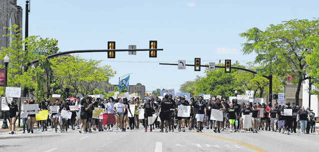 """Protesters march downtown Lima Saturday afternoon over the death of George Floyd, an unarmed black man who died after a policeman kneeled on his neck for several minutes in Minneapolis, Minnesota. This was the second time a """"No Justice, No Peace"""" march was held in Lima to protest violence done to minorities."""
