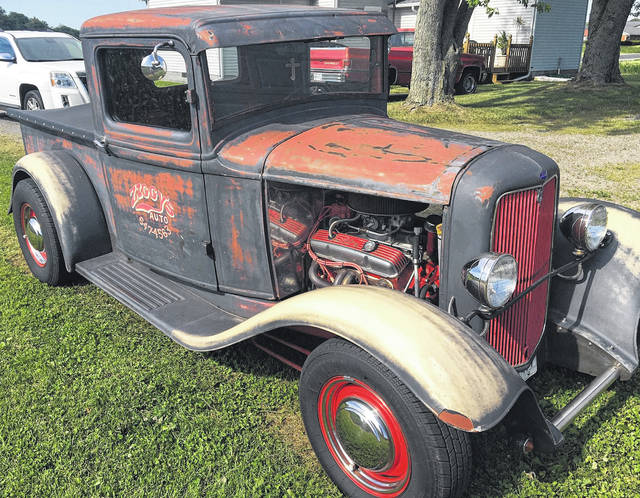 Wayne Sigler's work truck is a 1934 Ford with a 406 Chevy Engine. It advertises his shop name, Ziggy's Auto.