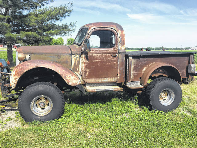 """Wayne Sigler, of Spencerville, build """"Frankenstein"""" with various components he found. It's a 1938 International cab, with a 1938 Dodge Sedan front end and a 1950 Chevy hood, all sitting on a Blazer chassis."""