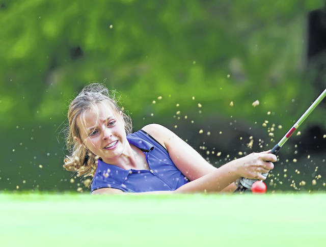 St. Henry's Ellen Naumann hits a shot from a bunker on the 18th hole during Tuesday's Reineke Ford Open at Colonial Golfers Club.