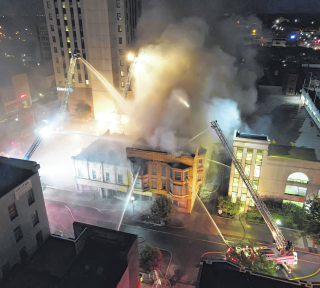 Firefighters from Lima, American Township and Shawnee Township fire departments battled a fire Tuesday night destroyed a 100-year-old building at 122 N. Elizabeth St. that most recently housed Roxy Food and Spirits.