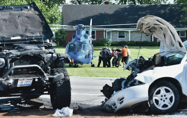 Terry E. Heitkamp, 48, of Minster, is carried to CareFlight after being involved in a three-vehicle crash in front of Mully's Drive-Thru on state Route 29 in McCartyville around 5:20 p.m. Wednesday. Heitkamp later died at Miami Valley Hospital, Dayton, of injuries sustained in the crash.