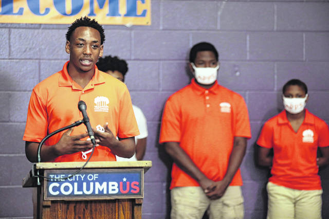 Daylon Humphries, 17, of Columbus, speaks about his experience with Columbus Parks and Recreation's APPS program during a press conference addressing a recent spike in violence on Saturday at the Milo-Grogen Community Center in Columbus.