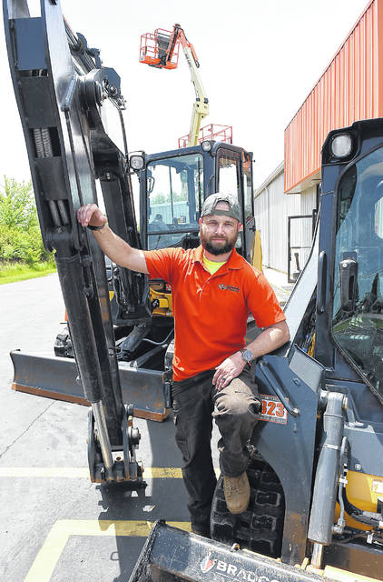 Stephen Barga, manager of Vandalia Rental, stands between some construction equipment at a new store located at 3901 Elida Road.