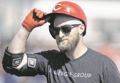 """Tucker Barnhart, the Cincinnati Reds' player representative, hopes """"that getting out and playing will kind of mask some of the bruises that the game as a whole has taken over the last few months."""""""