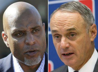 Union head Tony Clark, left, and baseball Commissioner Rob Manfred. (AP photos)