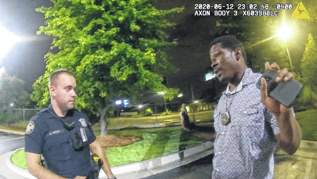 This screen grab taken from body camera video provided by the Atlanta Police Department shows Rayshard Brooks speaking with Officer Garrett Rolfe, left, in the parking lot of a Wendy's restaurant, late Friday.