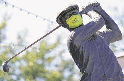 A statue of Ben Hogan sports a mask Wednesday at the Colonial Country Club in Fort Worth, Texas, home of the Charles Schwab Challenge.