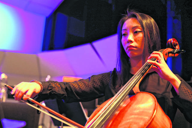 Xinya Zhou of Cincinatti practices her chello before The Lima Symphony Orchestra on Saturday evening.  Amanda Wilson -The Lima News