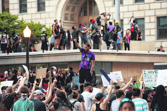 Protesters march back into the intersection of High and Broad street as protests continue following the death of Minneapolis resident George Floyd on Tuesday, June 2, 2020 in Columbus, (Joshua A. Bickel/The Columbus Dispatch via AP)