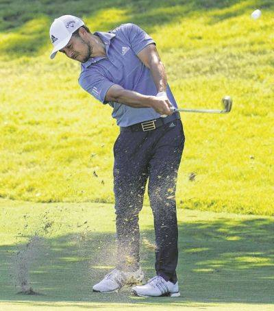 Xander Schauffele hits his second shot on the 18th hole during Saturday's third round of the Charles Schwab Challenge at the Colonial Country Club in Fort Worth, Texas.