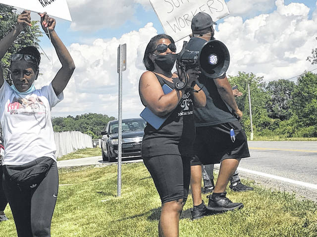 Protesters gathered outside the Ford Lima Engine Plant on Friday afternoon to raise concerns about systemic racism at the plant.