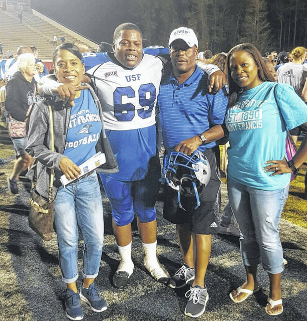 Brenda, Tank, Tony and Kami Wilkerson smile after St. Francis College in Fort Wayne won the 2016 NAIA national football championship.