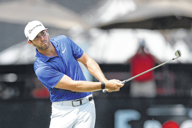 Matthew Wolff hits his second shot at the 11th green during the third round of the Rocket Mortgage Classic golf tournament, Saturday, July 4, 2020, at the Detroit Golf Club in Detroit. (AP Photo/Carlos Osorio)