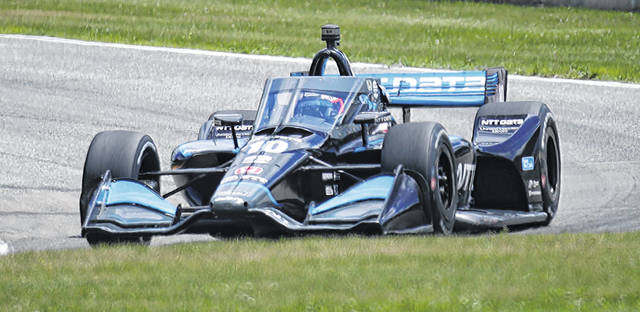 IndyCar driver Felix Rosenqvist (10) corners on Turn 3 during the REV Group Grand Prix auto race Sunday, July 12, 2020, at Road America in Elkhart Lake, Wis. (Gary C. Klein/The Sheboygan Press via AP)