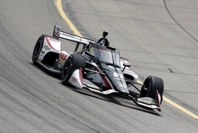 Rinus VeeKay, of The Netherlands, races his car during practice for an IndyCar Series auto race Saturday, July 18, 2020, at Iowa Speedway in Newton, Iowa. (AP Photo/Charlie Neibergall)