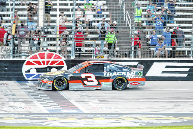 Austin Dillon crosses the finish line to win the NASCAR Cup Series auto race at Texas Motor Speedway in Fort Worth, Texas, Sunday, July 19, 2020. (AP Photo/Ray Carlin)